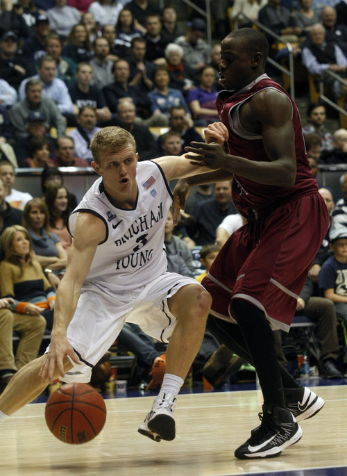 Chris Detrick  |  The Salt Lake Tribune Brigham Young Cougars guard Tyler Haws (3) is guarded by Loyola Marymount Lions guard Ayodeji Egbeyemi (24) during the second half of the game at  Thursday January 3, 2013.