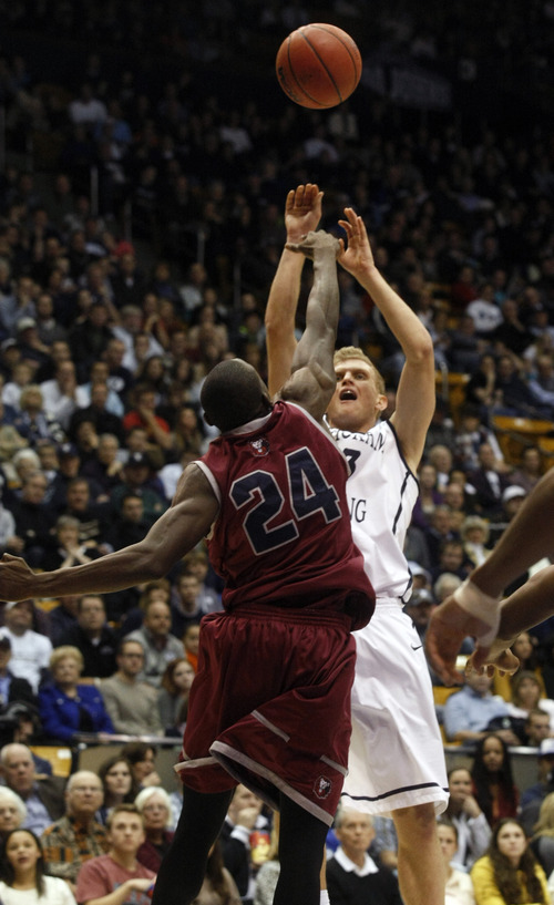Chris Detrick  |  The Salt Lake Tribune Brigham Young Cougars guard Tyler Haws (3) shoots over Loyola Marymount Lions guard Ayodeji Egbeyemi (24) during the second half of the game at  Thursday January 3, 2013.