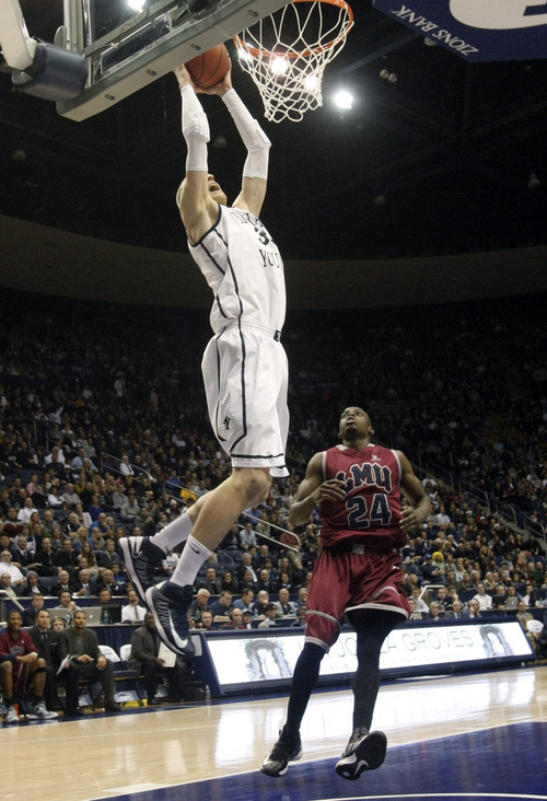 Chris Detrick  |  The Salt Lake Tribune Brigham Young Cougars forward Nate Austin (33) dunks the ball past Loyola Marymount Lions guard Ayodeji Egbeyemi (24) during the first half of the game at  Thursday January 3, 2013.  BYU is winning the game 35-20.