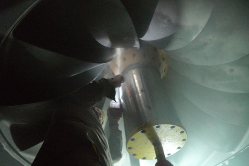 In this Thursday, Nov. 15, 2012 photo, a worker repairs a turbine inside the Kajaki power station at the dam in Helmand province, south of Kabul, Afghanistan. (AP Photo/Heidi Vogt)