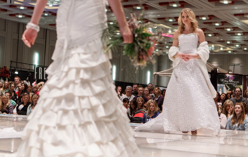 Trent Nelson  |  The Salt Lake Tribune Models walk the runway during a fashion show at the Bridal Showcase Saturday January 5, 2013 at the Salt Palace Convention Center in Salt Lake City.