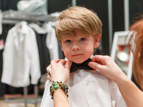 Trent Nelson  |  The Salt Lake Tribune Model Brixton Martinson gets a few final touches from his mother, Tiffany Martinson, before a fashion show at the Bridal Showcase Saturday January 5, 2013 at the Salt Palace Convention Center in Salt Lake City.