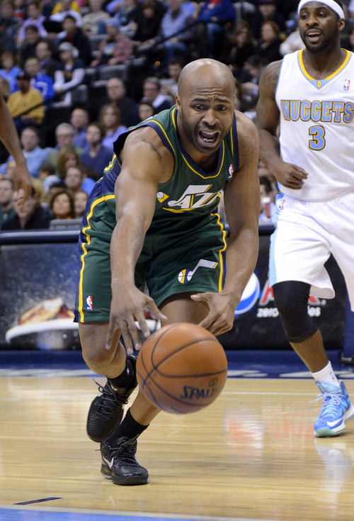 Utah Jazz point guard Jamaal Tinsley chases a loose ball during the third quarter of an NBA basketball game against the Denver Nuggets, Saturday, Jan. 5, 2013, in Denver. (AP Photo/Jack Dempsey)