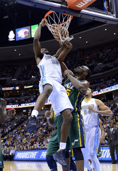 Denver Nuggets forward Kenneth Faried (35) dunks over Utah Jazz center Al Jefferson (25) during the first quarter of an NBA basketball game on Saturday, Jan. 5, 2013, in Denver. (AP Photo/Jack Dempsey)