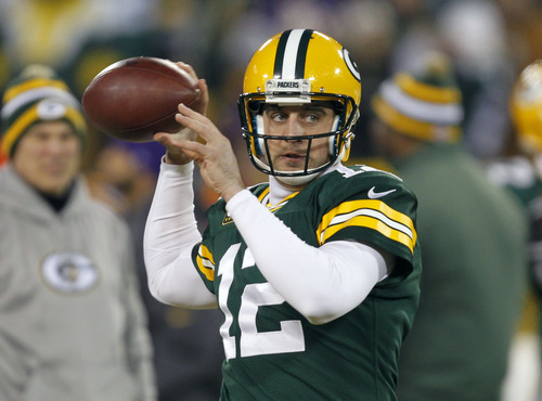 Green Bay Packers quarterback Aaron Rodgers warms up before an NFL wild card playoff football game against the Minnesota Vikings Saturday, Jan. 5, 2013, in Green Bay, Wis. (AP Photo/Mike Roemer)