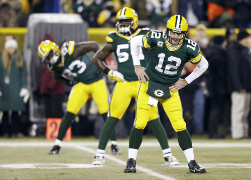 Green Bay Packers quarterback Aaron Rodgers (12) warms up before an NFL wild card playoff football game against the Minnesota Vikings Saturday, Jan. 5, 2013, in Green Bay, Wis. (AP Photo/Jeffrey Phelps)