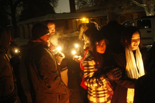 """Chris Detrick     The Salt Lake Tribune Family and friends of Matthew Stewart participate in """"a candlelight time of silence for peace,"""" across from Stewart's home in Ogden Friday January 4, 2013."""