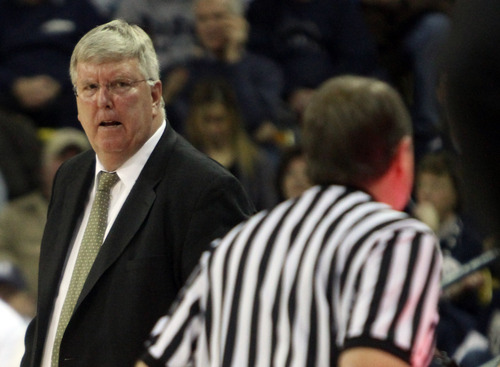 Rick Egan  | The Salt Lake Tribune   Utah State Aggies head coach Stew Morrill disputes a call by the referee, in basketball action Utah State vs. The Idaho Vandals,  in Logan, Saturday, January 5, 2013.