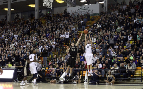 Rick Egan  | The Salt Lake Tribune   Utah State Aggies guard Preston Medlin (13) shoots a 3-pointer at the buzzer tying the game at 69-69 sending the game into overtime, in basketball action Utah State vs. The Idaho Vandals,  in Logan, Saturday, January 5, 2013.