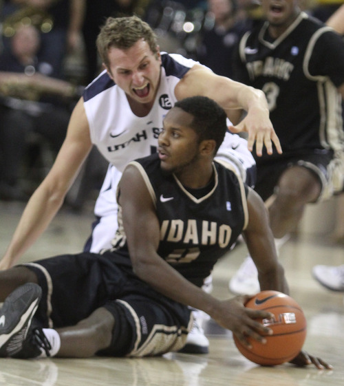 Rick Egan  | The Salt Lake Tribune   Utah State Aggies forward Ben Clifford (1)tries to get the ball from Idaho Vandals guard Connor Hill (5),  in basketball action Utah State vs. The Idaho Vandals,  in Logan, Saturday, January 5, 2013.