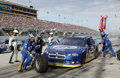 Driver Brad Keselowski's pit crew change tires during the NASCAR Sprint Cup Series auto race at Homestead-Miami Speedway Sunday, Nov. 18, 2012 in Homestead, Fla.  The race will determine NASCAR's top team. (AP Photo/Terry Renna)