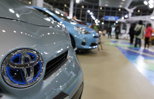 (AP Photo/Shizuo Kambayashi) In 2012, Toyota leapfrogged General Motors and Volkswagen to regain its title as the world's largest automaker, selling 9.7 million vehicles, a record for the company.