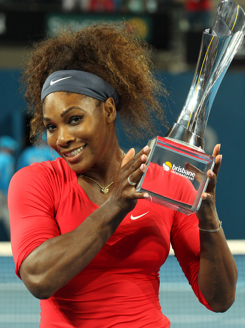 Serena Williams of the United States poses with the trophy after winning the women's final match against Anastasia Pavlyuchenkova of Russia during the Brisbane International tennis tournament in Brisbane, Australia, Saturday, Jan. 5, 2013. Williams captured her 47th career title with a comprehensive 6-2, 6-1 victory over Pavlyuchenkova in Saturday's Brisbane International final. (AP Photo/Tertius Pickard)
