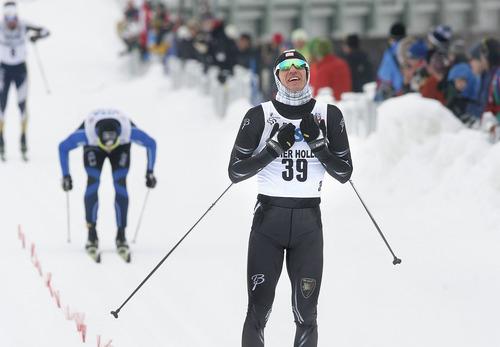 Scott Sommerdorf   |  The Salt Lake Tribune Torin Koos, #39, reacts as he crosses the finish line to win the Senior Men's U.S. Championship 30k at Soldier Hollow, Sunday, January 6, 2013. Erik Bjornsen was second with David Norris third.