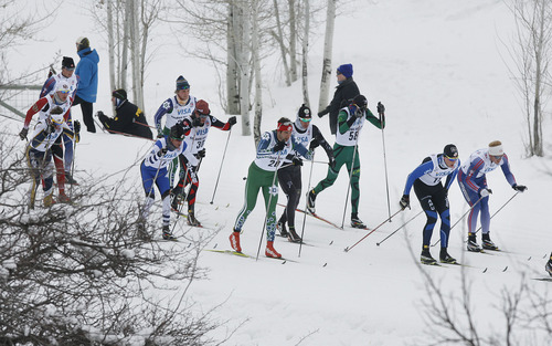 Scott Sommerdorf   |  The Salt Lake Tribune A group of racers makes their way through a wooded part of the course during the Senior Men's U.S. Championship 30k at Soldier Hollow, Sunday, January 6, 2013.