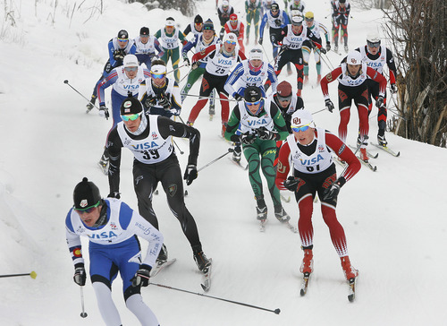 Scott Sommerdorf   |  The Salt Lake Tribune Torin Koos, #39, second from left, who would end up winning the race, bides his time in the center of a pack of leaders as they round a turn halfway through the race. Senior Men's U.S. Championship 30k at Soldier Hollow, Sunday, January 6, 2013.