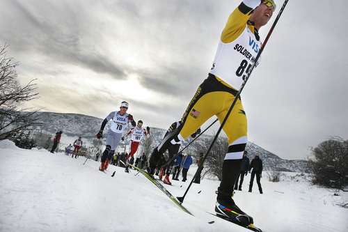 Scott Sommerdorf   |  The Salt Lake Tribune Jay Woodbeck of Michigan Tech University leads a group of racers into a turn during the Senior Men's U.S. Championship 30k at Soldier Hollow, Sunday, January 6, 2013.