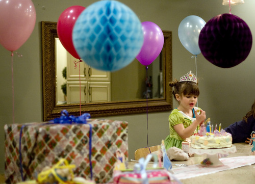 Kim Raff     The Salt Lake Tribune LuLu Badger, who received a liver transplant in 2010, eats candy off of her birthday cake while celebrating her fourth birthday in her home in Salt Lake City on December 8, 2012.