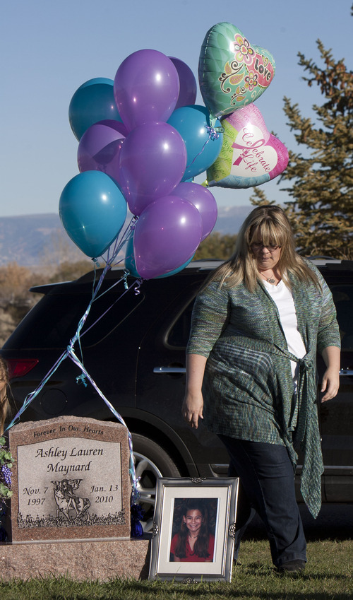 Steve Griffin    The Salt Lake Tribune Camie Lacey walks past the grave of her daughter, Ashley Maynard, at the Vernal Cemetery in Vernal, Utah Saturday October 27, 2012. Ashley, 12, died in 2010. Maynard's family donated her organs, and her liver saved LuLu Badger's life. The two families have become friends and met in the small Utah town for the kids to visit a corn maze and visit Ashley's grave.