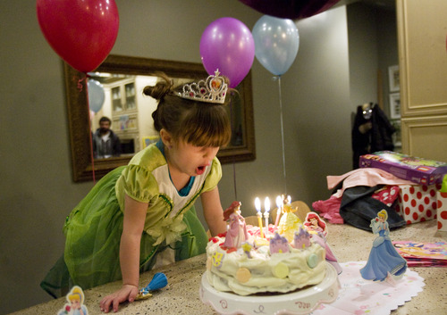 Kim Raff     The Salt Lake Tribune LuLu Badger, who received a liver transplant in 2010, looks at her birthday cake while celebrating her fourth birthday in her home in Salt Lake City on December 8, 2012.
