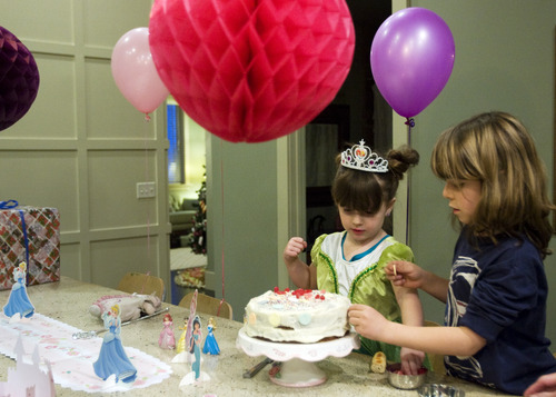 Kim Raff     The Salt Lake Tribune LuLu Badger, who received a liver transplant in 2010, decorates her birthday cake with her brother, Jonah Badger, while celebrating her 4th birthday in her home in Salt Lake City on December 8, 2012.