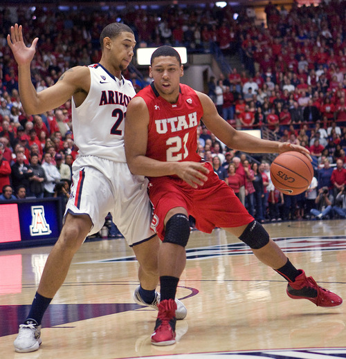 Utah's Jordan Loveridge (21) drives to the basket around Arizona's Brandon Ashley during the first half of an NCAA college basketball game at McKale Center in Tucson, Ariz., Saturday, Jan. 5, 2013. (AP Photo/Wily Low)