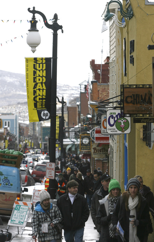 Rick Egan  | The Salt Lake Tribune   Film lovers and autograph seekers, walk up Main Street in Park City, Friday, January 20, 2012.
