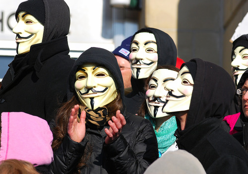 Activists from the online group KnightSec and Anonymous protest at the Jefferson County Courthouse in Steubenville, Ohio, Saturday, Jan. 5, 2013. Members of the group said they are outraged over what they contend is a cover-up in a case involving the alleged rape of a teenage girl by Steubenville High School student-athletes that reportedly occurred in 2012.  (AP Photo/Steubenville Herald-Star, Michael D. McElwain)