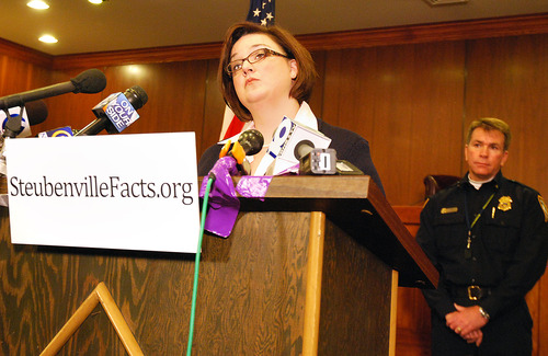 Steubenville City Manager Cathy Davison announces the launch of SteubenvilleFacts.org, a website designed to respond to rumors with facts during a press conference held Saturday, January 5, 2013, in Steubenville, Ohio, City Hall. Behind her is Steubenville Police Chief Bill McCafferty. (AP Photo/Steubenville Herald-Star, Michael D. McElwain)