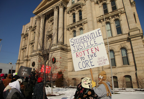 Activists from the online group KnightSec and Anonymous protest at the Jefferson County Courthouse in Steubenville, Ohio, Saturday, Jan. 5, 2013. Members of the group said they are outraged over what they contend is a cover-up in a case involving the alleged rape of a teenage girl by Steubenville High School student-athletes that reportedly occurred in 2012. (AP Photo/The Plain Dealer, Thomas Ondrey) MANDATORY CREDIT; NO SALES