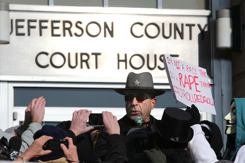 """Jefferson County sheriff Fred Abdalla addresses the crowd at the Jefferson County Courthouse in Steubenville, Ohio, Saturday, Jan. 5, 2013. Authorities investigating rape accusations against two high school football players in eastern Ohio launched a website Saturday as interest in the case balloons, an extraordinary step designed to combat the misperception """"that the football team runs the city,"""" the city manager said. (AP Photo/The Plain Dealer, Thomas Ondrey) MANDATORY CREDIT; NO SALES"""