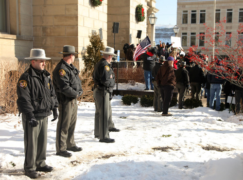 """Jefferson Co. sheriff's deputies stand nearby during the  protest at the Jefferson County Courthouse in Steubenville, Ohio, Saturday, Jan. 5, 2013. Authorities investigating rape accusations against two high school football players in eastern Ohio launched a website Saturday as interest in the case balloons, an extraordinary step designed to combat the misperception """"that the football team runs the city,"""" the city manager said. (AP Photo/The Plain Dealer, Thomas Ondrey) MANDATORY CREDIT; NO SALES"""