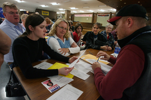 Steve Griffin     The Salt Lake Tribune  Democrats attend party caucuses Tuesday night at Eisenhower Junior High School in Taylorsville. Delegates elected at 148 locations around the state will shape the candidate lineup for this year's election -- choosing nominees in races from governor to the Legislature and county elections.