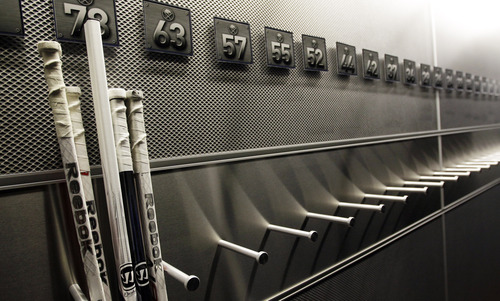 FILE - In this Sept. 25, 2012 file photo,  a nearly empty hockey stick rack in the locker room of the Buffalo Sabres hockey team is shown during the NHL labor lockout in Buffalo, N.Y.  (AP Photo/David Duprey, File)