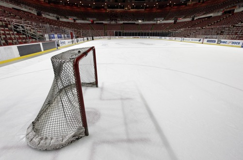 In this photo taken Tuesday, Dec. 18, 2012, a hockey goal sits on the ice at Joe Louis Arena home of the Detroit Red Wings hockey club in Detroit.  (AP Photo/Paul Sancya, File)