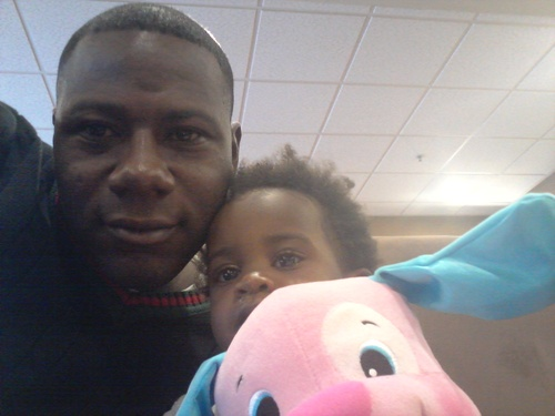 Courtesy Terry Achane, of South Carolina, with his daughter, whom he named Teleah, after a court hearing in Utah. The child, now 21 months, was placed for adoption at birth without his knowledge or consent.