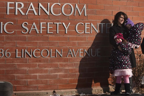 Leah Hogsten  |  The Salt Lake Tribune Jared Francom's wife, Erin Francom, and their daughters Samantha, 6, and Hailey, 4, attended a ceremony on Friday to rename the Ogden Public Safety Building to the Francom Public Safety Center in honor of Jared Francom, who was killed one year ago in the line of duty. The renaming ceremony recognized Francom and other officers injured in the shooting.