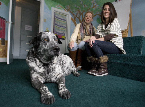 Paul Fraughton    The Salt Lake Tribune Bruno, a 13-year-old therapy dog, sits in an interview room at Tooele County's Children's Justice Center with executive director Carolyn Jensen, left, and Sylvia Allred, a child advocate. Jensen said that four years ago her center became the first of its kind in the nation to use service dogs to help children. The program began with two retired search and rescue dogs, though today only Bruno remains.