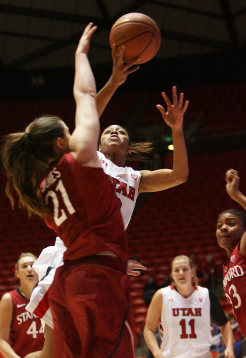 Kim Raff | The Salt Lake Tribune University of Utah player (middle) Iwalani Rodrigues takes a shot as Stanford player Sara James defends during a game at the Huntsman Center in Salt Lake City on January 6, 2013. Stanford went on to win the game 70-56.