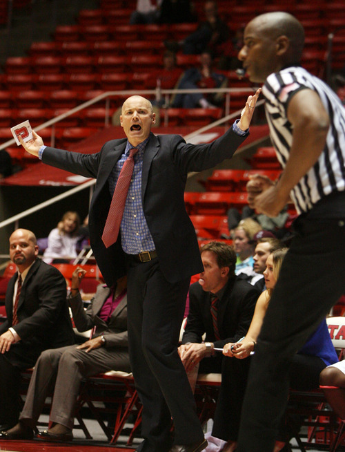 Kim Raff | The Salt Lake Tribune University of Utah head coach Anthony Levrets argues a referee call from the sidelind during a game against Stanford at the Huntsman Center in Salt Lake City on January 6, 2013. Stanford went on to win the game 70-56.