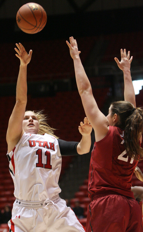 Kim Raff | The Salt Lake Tribune University of Utah player (left) Taryn Wicijowski takes a shot as Stanford player (right) Chelsea Bridgewater defends at the Huntsman Center in Salt Lake City on January 6, 2013. Stanford went on to win the game 70-56.