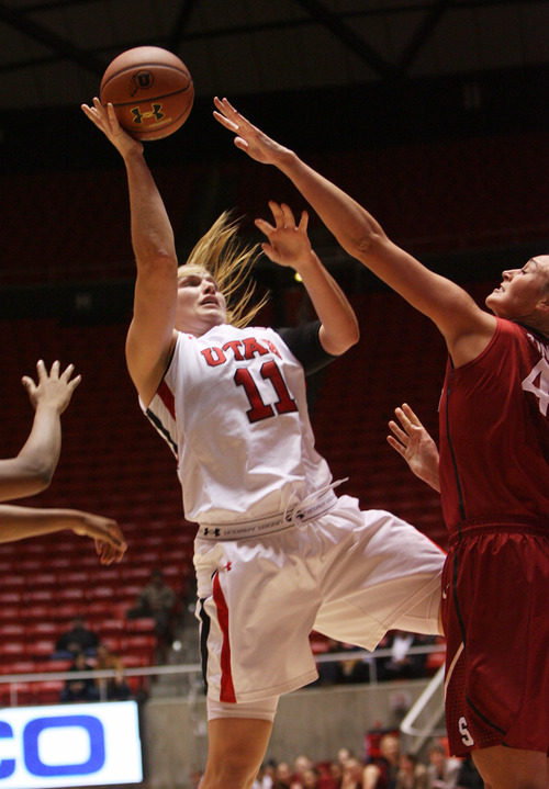 Kim Raff | The Salt Lake Tribune University of Utah player (left) Taryn Wicijowski takes a shot as Stanford player (right) Joslyn Tinkle defends during a game at the Huntsman Center in Salt Lake City on January 6, 2013. Stanford went on to win the game 70-56.