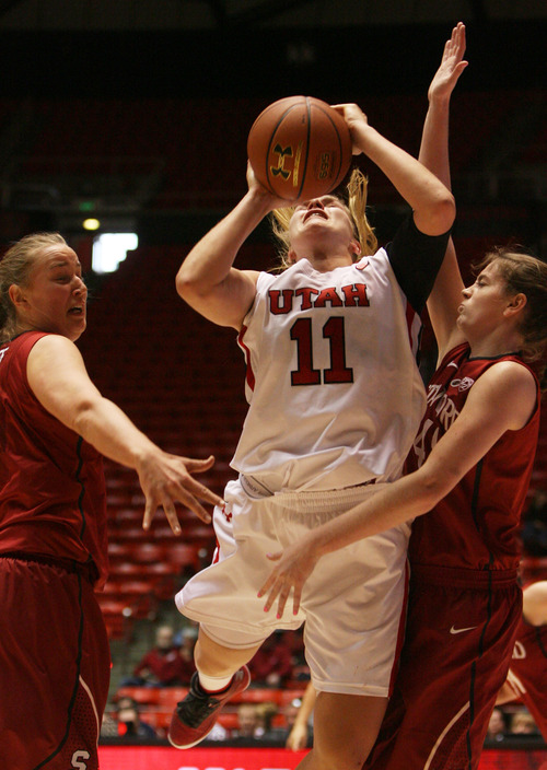 Kim Raff | The Salt Lake Tribune University of Utah player (middle) Taryn Wicijowski takes a shot as Stanford players (left) Mikaela Ruef (right) Bonnie Samuelson defends during a game at the Huntsman Center in Salt Lake City on January 6, 2013. Stanford went on to win the game 70-56.