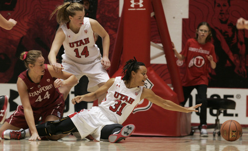Kim Raff | The Salt Lake Tribune University of Utah player (right) Ciera Dunbar reaches for a loose ball as Utah player (middle) Paige Crozon and Stanford player (left) Joslyn Tinkle watch during a game against Stanford at the Huntsman Center in Salt Lake City on January 6, 2013. Stanford went on to win the game 70-56.