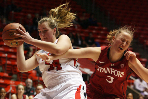 Kim Raff | The Salt Lake Tribune University of Utah player (left) Paige Crozon grabs a rebound from Stanford player Mikaela Ruef during a game at the Huntsman Center in Salt Lake City on January 6, 2013. Stanford went on to win the game 70-56.