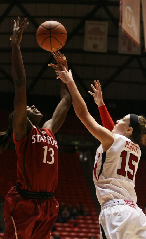Kim Raff | The Salt Lake Tribune (right) University of Utah player Michelle Plouffe competes for a rebound with Stanford player (left) Chiney Ogwumike during a game at the Huntsman Center in Salt Lake City on January 6, 2013. Stanford went on to win the game 70-56.