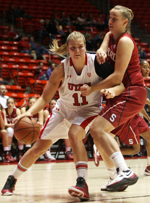 Kim Raff | The Salt Lake Tribune (left) University of Utah player Taryn Wicijowski tries to dribble past Stanford player Mikaela Ruef during a game at the Huntsman Center in Salt Lake City on January 6, 2013. Stanford went on to win the game 70-56.