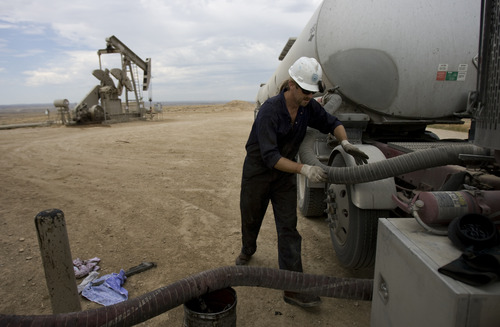 Kim Raff | The Salt Lake Tribune Ralph Walker, an oil truck driver for Flying J, fills up his truck with oil from an oil pumping station in Newfield Exploration Company's oil fields in Monument Butte near Roosevelt, Utah on August 9, 2012.