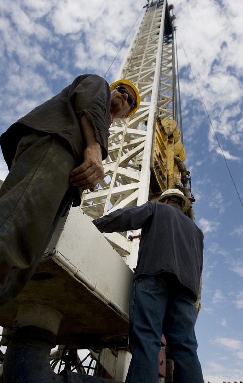 Kim Raff | The Salt Lake Tribune Floorhands work on a super single oil rig's drilling platform in the Newfield Exploration Company's oil fields in Monument Butte near Roosevelt.