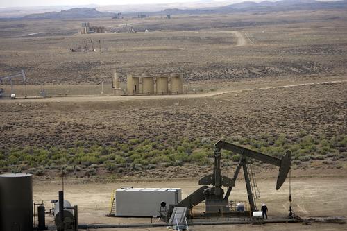 Kim Raff | The Salt Lake Tribune Oil pumpers dot the landscape of Newfield Exploration Company's oil fields in Monument Butte near Roosevelt.